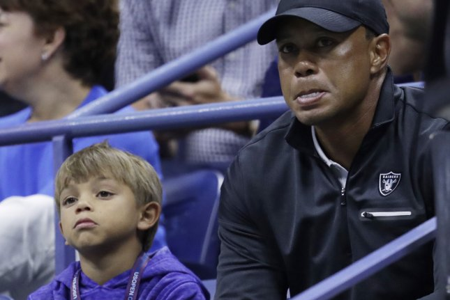 Charlie Woods (L) and his father Tiger Woods (R) will compete for the first time together in an official tournament in December's 2020 PNC Championship in Orange County, Fla. File Photo by John Angelillo/UPI