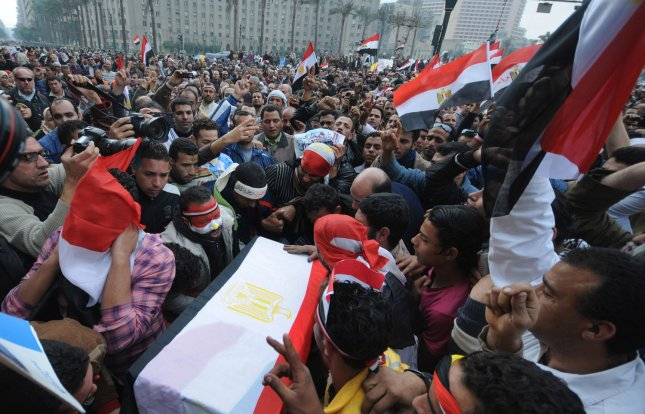 Egyptian anti-government demonstrators hold a symbolic funeral for colleague Ahmed Mohammed Mahmud , killed during clashes with pro-government supporters on February 4, at Cairo's Tahrir Square on February 7, 2011 on the 14th day of protests calling for the ouster of President Hosni Mubarak. UPI