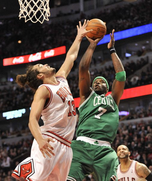 Boston Celtics center Jermaine O'Neal (R) goes up for a shot as Chicago Bulls center Joakim Noah defends during the second quarter at the United Center in Chicago, Feb. 16, 2012. UPI/Brian Kersey