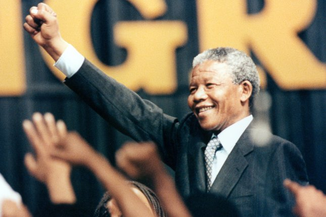 Nelson Mandela raises his fist to the crowd at the Washington Convention Center during his introduction June 26, 1990. Mandela spoke to a crowd of more than 19,000 people gathered to honor him. (UPI PHOTOS/Martin Jeong/FILES)