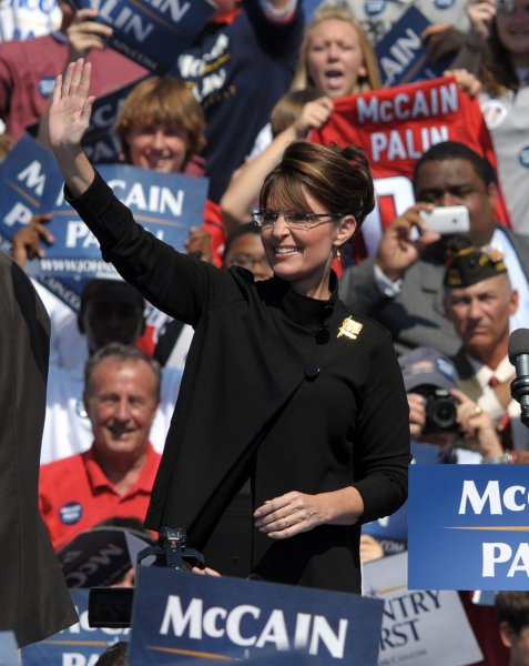 Vice Presidential Nominee Alaska Gov. Sarah Palin waves to supporters at a campaign rally for her and Republican Presidential Nominee Sen. John McCain (AZ) in Fairfax, Virginia, on September 10, 2008. (UPI Photo/Roger L. Wollenberg)