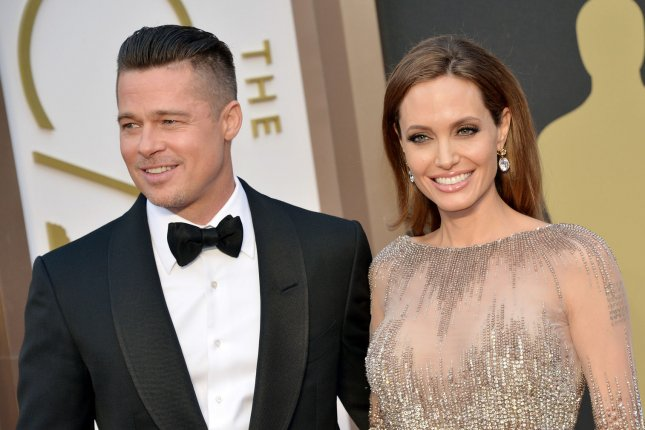 Angelina Jolie and Brad Pitt arrive on the red carpet at the 86th Academy Awards at Hollywood & Highland Center in the Hollywood section of Los Angeles on March 2, 2014. UPI/Kevin Dietsch