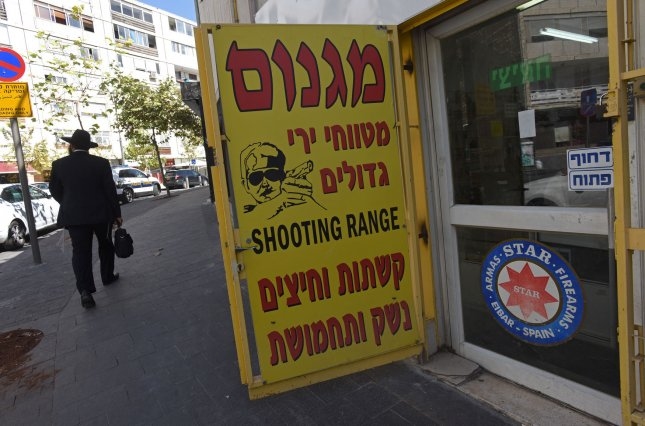 A religious Jew walks past a firearms store in central Jerusalem, Israel, October 11, 2015. There has been a sharp increase in Israelis applying for firearm permits following a wave of stabbing attacks by Palestinians. Two incidents of stabbings of Israeli border officers were reported Monday. Photo by Debbie Hill/ UPI