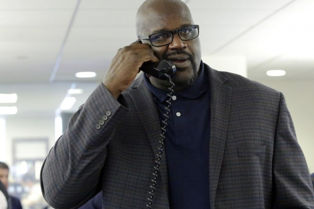 Shaquille O'Neal speaks to a client at the 2016 BTIG Commissions for Charity Day in New York City on May 10, 2016. O'Neal appeared on The Tonight Show to challenge Jimmy Fallon to a Lip Sync Battle. File Photo by John Angelillo/UPI