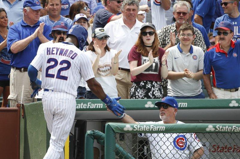 Chicago Cubs' Jason Heyward celebrates with manager Joe Maddon after a home run. File photo by Kamil Krzaczynski/UPI