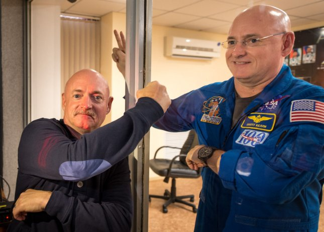 Mark Kelly, left, who flew four space shuttle missions and commanded the final flight of Space Shuttle Endeavour, participated in biomedical studies on the ground while his twin, Scott, was on board the International Space Station in 2015. NASA Photo by Bill Ingalls/UPI