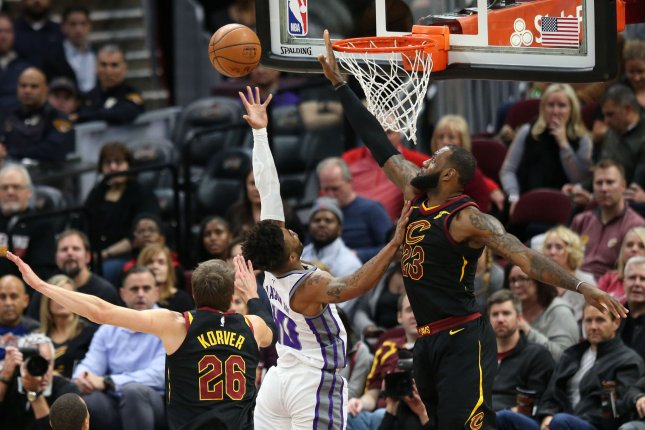 Sacramento Kings guard Frank Mason III puts up a shot between Cleveland Cavaliers defenders Kyle Korver (26) and LeBron James (23) during the first half on December 6, 2017 at Quicken Loans Arena in Cleveland. Photo by Aaron Josefczyk/UPI