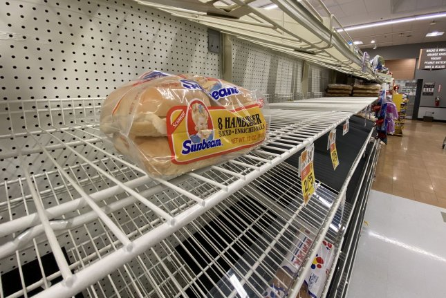 With bread aisles almost bare, more consumers are turning to home baking. File Photo by David Tulis/UPI