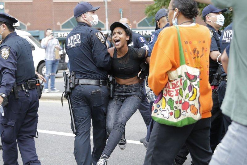 https://cdnph.upi.com/svc/sv/upi/1791590746556/2020/4/87977b9761be7e7780b321e3b3dc797f/Minneapolis-cop-seen-kneeling-on-George-Floyd-charged-with-murder.jpg