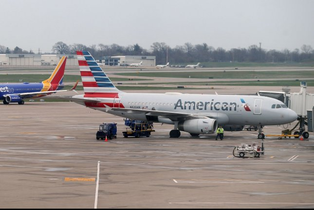 An American Airlines jetliner is parked at a terminal at St. Louis-Lambert International Airport in St. Louis, Mo. Thursday's deal allows both carriers to begin operating new routes. File Photo by Bill Greenblatt/UPI