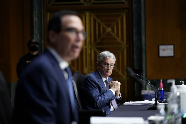 Treasury Secretary Steven Mnuchin (L) testifies Tuesday as Federal Reserve Chairman Jerome Powell listens at a Senate Banking Committee hearing on Capitol Hill. Pool Photo by Susan Walsh/UPI