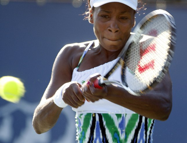 Venus Williams returns a shot while defeating Stephanie Dubois of Canada in the first round of the Bank of the West Classic at Stanford University in Palo Alto, California on July 28, 2009. UPI/Terry Schmitt