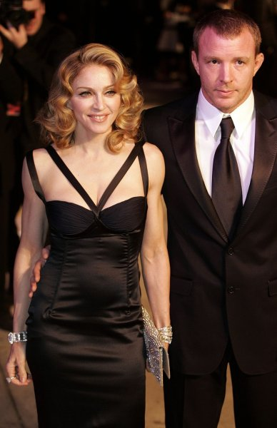 Madonna (L) and Guy Ritchie (R) arrive at the Vanity Fair post-79th Academy Awards party at Morton's in West Hollywood on February 25, 2007. (UPI Photo/Gary C. Caskey)