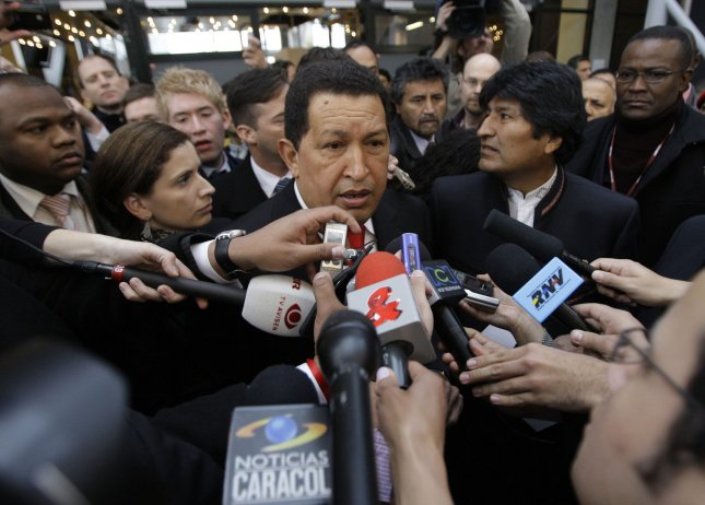 Venezuela's President Hugo Chavez (C) talks to the media as he arrives with Bolivian President Evo Morales (2nd R) at a plenary session of the United Nations Climate Change Conference in Copenhagen, Denmark, on December 18, 2009. UPI/Anatoli Zhdanov