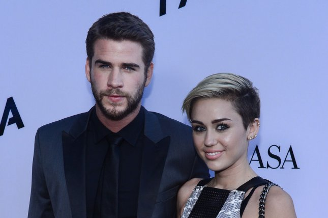 Cast member Liam Hemsworth and actress and singer Myley Cyrus attends the premiere of the motion picture thriller Paranoia on August 8, 2013. File Photo by Jim Ruymen/UPI