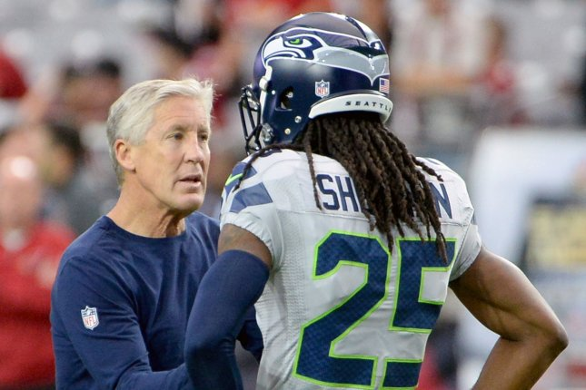 Seattle Seahawks head coach Pete Carroll talks with defensive back Richard Sherman before the Seahawks-Arizona Cardinals game at University of Phoenix Stadium in Glendale, Arizona, October 23, 2016. Photo by Art Foxall/UPI