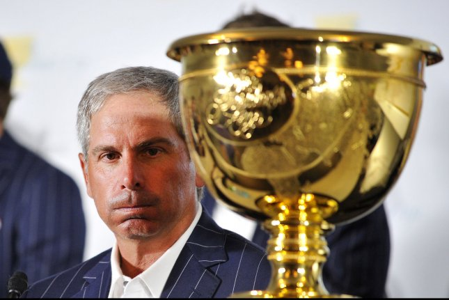 United States Team captain Fred Couples sits with the Presidents Cup UPI/Brian Kersey