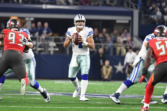 Dallas Cowboys quarterback Dak Prescott looks to throw against the Tampa Bay Buccaneers during the first half at AT&T Stadium in Arlington, Texas on December 18, 2016. File photo by Ian Halperin/UPI