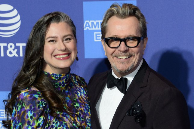 Gary Oldman (R) and his wife Gisele Schmidt. The actor will be portraying Citizen Kane co-writer Herman Mankiewicz in a new film from director David Fincher. File Photo by Jim Ruymen/UPI