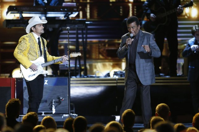 Charlie Pride (R) sings in the opening act of the 2016 Country Music Awards at Bridgestone Arena in Nashville, Tennessee on November 2, 2016. Photo by John Sommers II/UPI