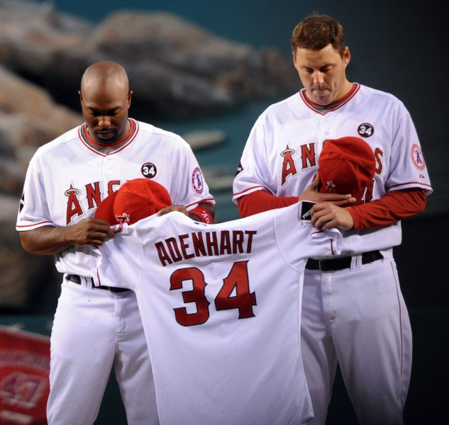 Los Angeles Angels center fielder Torii Hunter (L) and starting pitcher John Lackey pay respect during a moment of silence for Los Angeles Angels rookie pitcher Nick Adenhart before their baseball game with the Boston Red Sox in Anaheim, California on April 10, 2009. (UPI Photo/Jim Ruymen)