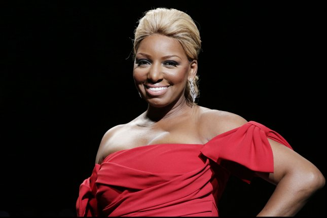 NeNe Leakes walks on the runway in The Heart Truth Red Dress Collection 2014 fashion show in New York City on Feb. 6, 2014. The reality television personality is joining the cast of Broadway's Chicago. File Photo by John Angelillo/UPI
