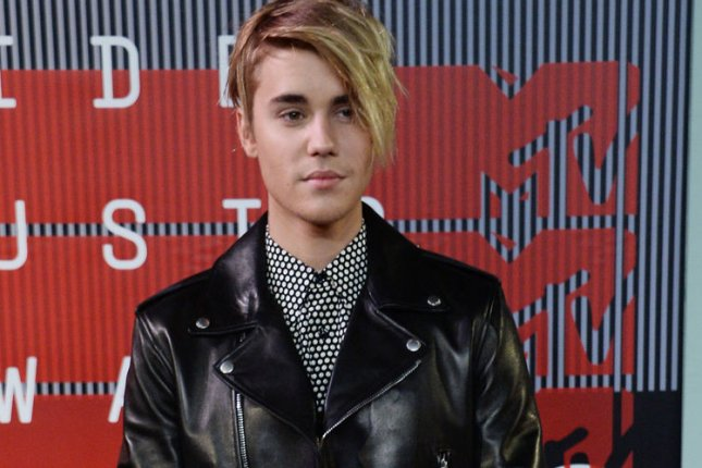 Singer Justin Bieber, seen here arriving at this year's MTV Video Music Awards, released his new single Sorry, Friday alongside a dance video for the tune. File Photo by Jim Ruymen/UPI
