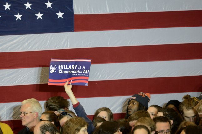 A supporter of former Secretary of State Hillary Clinton holds up a sign at a Caucus Night Victory Party in Des Moines on February 1, 2016. Clinton claimed a narrow win over Vermont Sen. Bernie Sanders, in the first election contest. Photo by Mike Theiler/UPI