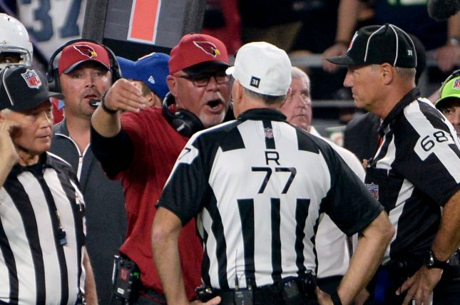 Arizona Cardinals' head coach Bruce Arians (C) has words with referee Terry McAulay (77) over a field goal attempt in the second quarter of the Cardinals-Seattle Seahawks game at University of Phoenix Stadium in Glendale, Arizona, October 23, 2016. Photo by Art Foxall/UPI