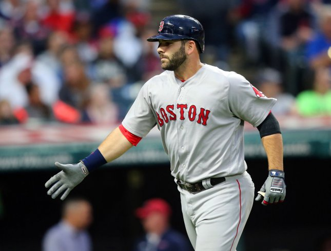 Mitch Moreland and the Boston Red Sox cruised past the Cincinnati Reds on Saturday. Photo by Aaron Josefczyk/UPI