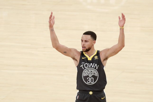 Golden State Warriors guard Stephen Curry reacts after hitting a 3-point shot and getting fouled in the third quarter against the New York Knicks on February 26, 2018 at Madison Square Garden in New York City. Photo by John Angelillo/UPI