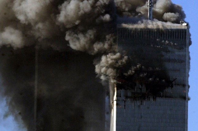 The World Trade Center twin towers burn after two commercial airliners deliberately crashed into the buildings on September 11, 2001, in New York. File Photo by Ezio Petersen/UPI