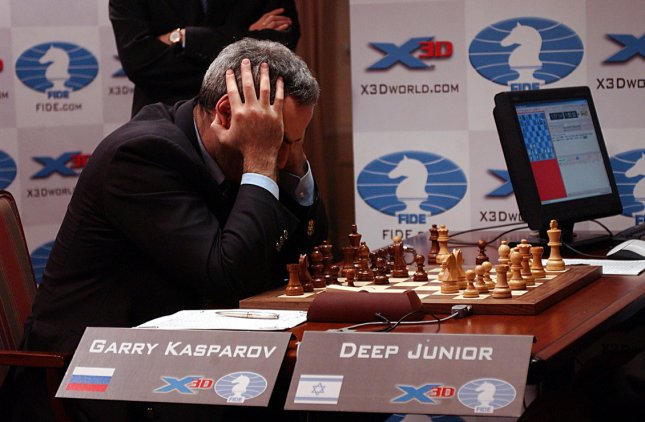 Chess Grand Master Garry Kasparov studies the board against the chess supercomputer Deep Junior during their sixth and final match on Feb. 7, 2003 in New York City. Kasparov and the Deep Junior computer concluded their match in a tie. rlw/ep/Ezio Petersen UPI
