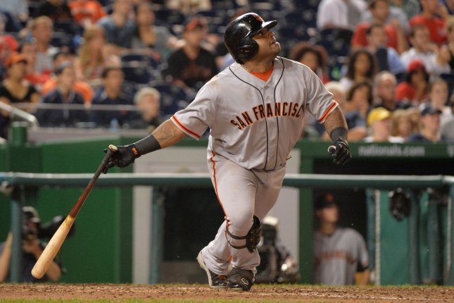San Francisco Giants Pablo Sandoval watches his hit against the Washington Nationals at Nationals Park on August 13, 2013 in Washington, D.C. The Nationals defeated the Giants 4-2. UPI/Kevin Dietsch