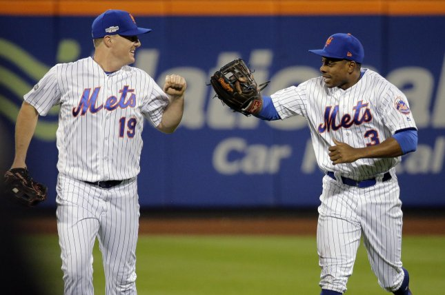 New York Mets center fielder Curtis Granderson (3) is congratulated by right fielder Jay Bruce (19). File photo by Ray Stubblebine/UPI