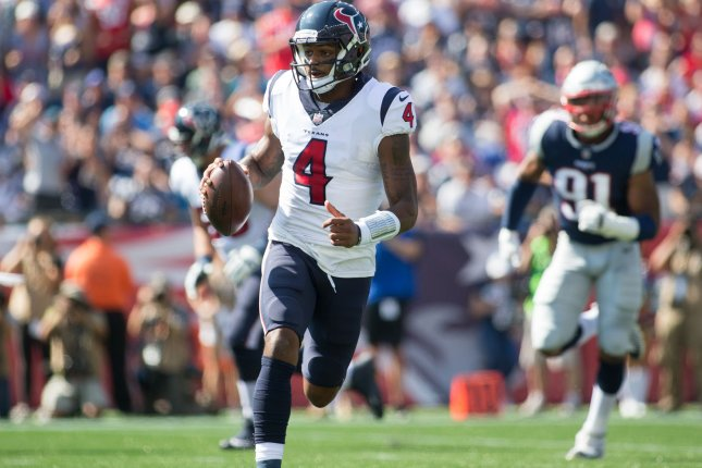 Houston Texans quarterback Deshaun Watson (4) scrambles with the ball in the first quarter against the New England Patriots at Gillette Stadium on September 24 in Foxborough, Mass. Photo by Matthew Healey/UPI