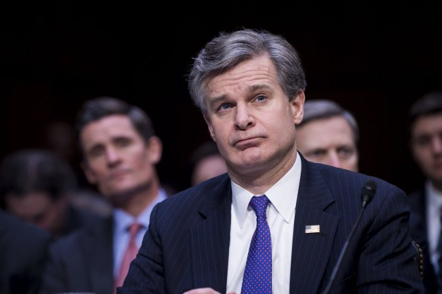FBI Director Christopher Wray testifies before the Senate Select Intelligence committee during a hearing about World Wide Threats, on Tuesday in Washington, DC. Wray was one of several intelligence officials who warned against the use of Chinese brand smartphones. Photo by Pete Marovich/UPI