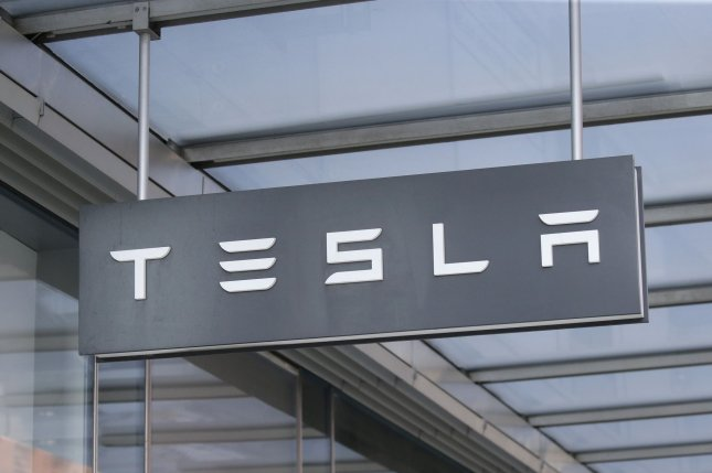 Tesla reported a record net income of more than $1 billion for the first time as its second-quarter earnings report exceeded expectations on Monday. File Photo by John Angelillo/UPI