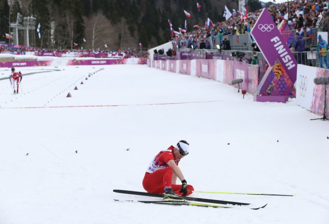 Gold medalist Switzerland's Dario Cologna rests at the finish line after competing at the men's 15km cross country classic at the Sochi 2014 Winter Olympics on February 14, 2014 in Krasnaya Polyana, Russia. UPI/Molly Riley