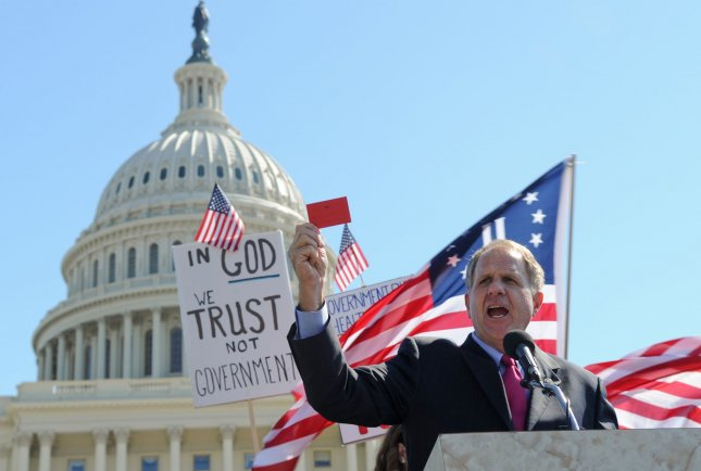 Rep. Ted Poe (R-TX) speaks to Tea Party activists as they rally on the west side of the U.S. Capitol in Washington on March 20, 2010. UPI/Alexis C. Glenn