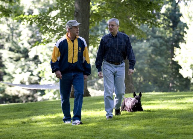 Physicians who give colonoscopies improve if given report cards. U.S. President George W. Bush (L) and Chief of Staff Josh Bolten walk with the President's dog, Barney, at Camp David on July 21, 2007. President Bush underwent a colonoscopy while at Camp David where doctors found and removed five small polyps. (UPI Photo/Eric Draper/White House Press Office)