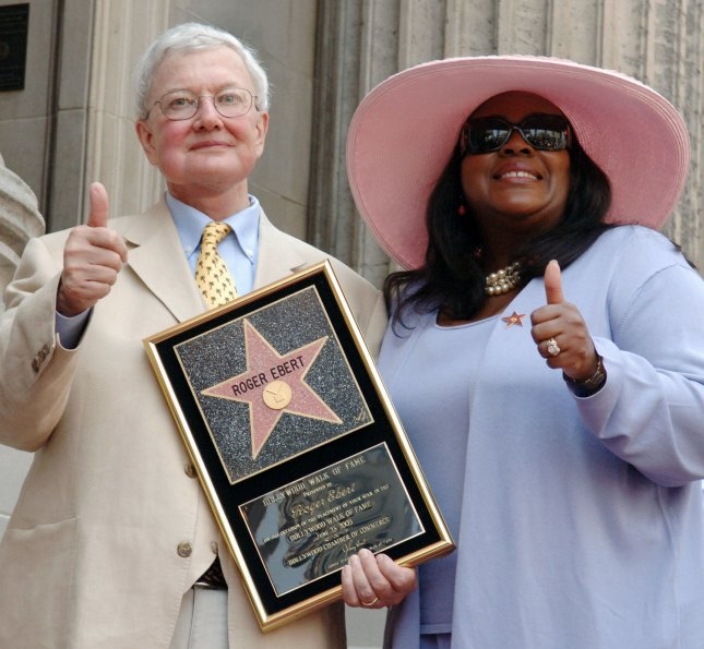 Film critic Roger Ebert and his wife Chaz give duel thumbs up during a Hollywood Walk of Fame ceremony honoring Ebert with the 2,288th star on the famous walkway in Los Angeles June 23, 2005. (UPI Photo/Jim Ruymen)