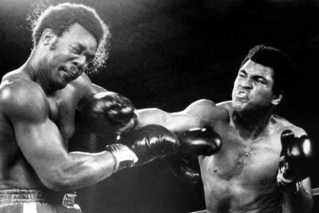 Muhammad Ali rocks George Foreman with a hard right during their heavyweight title bout on October 29, 1974 in Kinshasa, Zaire. Ali knocked Foreman out in the 8th round to regain his heavyweight crown. (UPI/File)
