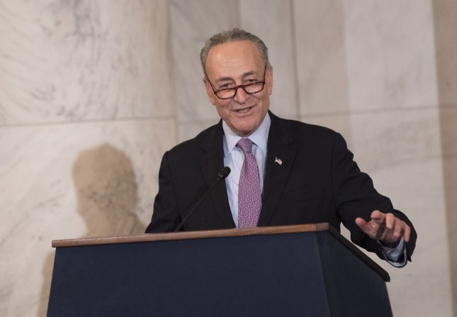 Sen. Charles Schumer, D-N.Y., assailed airlines' new practice of charging for use of overhead luggage bins, saying he would push for an expansion of the passenghers' bill of rights. File Photo by Kevin Dietsch/UPI