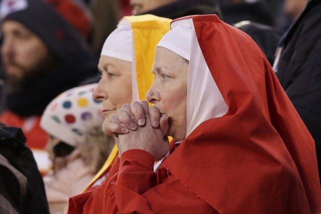 Kansas City Chiefs fans dressed as nuns react watching the final minute of the game against the New York Jets in Week 13 of the NFL season on December 3 at MetLife Stadium in East Rutherford, N.J. Photo by John Angelillo/UPI