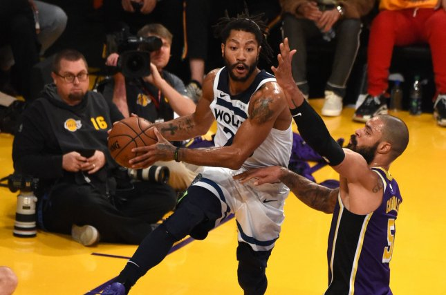 Minnesota Timberwolves guard Derrick Rose (L) hangs in the air by Los Angeles Lakers center Tyson Chandler on November 7 at Staples Center in Los Angeles. Photo by Jon SooHoo/UPI