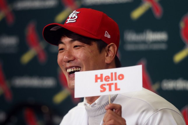 Korean left-handed pitcher Kwang-Hyun Kim holds up a sign during a press conference announcing the St. Louis Cardinals have signed him to a two-year contract Tuesday at Busch Stadium in St. Louis. Photo by Bill Greenblatt/UPI