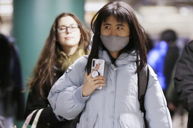 A woman wears a mask covering her mouth and nose while walking through the subway in New York City on January 27, 2020 in New York City. 106 people have died and more than 4,500 cases have been confirmed in mainland China, as the Wuhan coronavirus spreads across Asia and the rest of the world. Photo by John Angelillo/UPI
