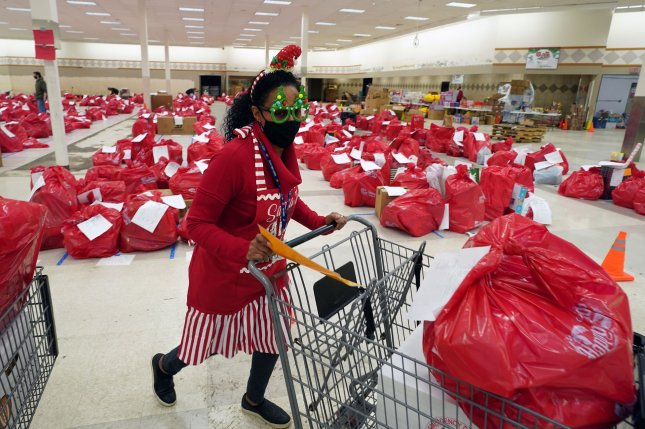 A volunteer picks up toys for a client at the Salvation Army Toy Town in St. Ann, Missouri, on December 17, 2020. Shipping delays and the coronavirus pandemic could snarl delivery of toys and other products this year, experts said. Photo by Bill Greenblatt/UPI