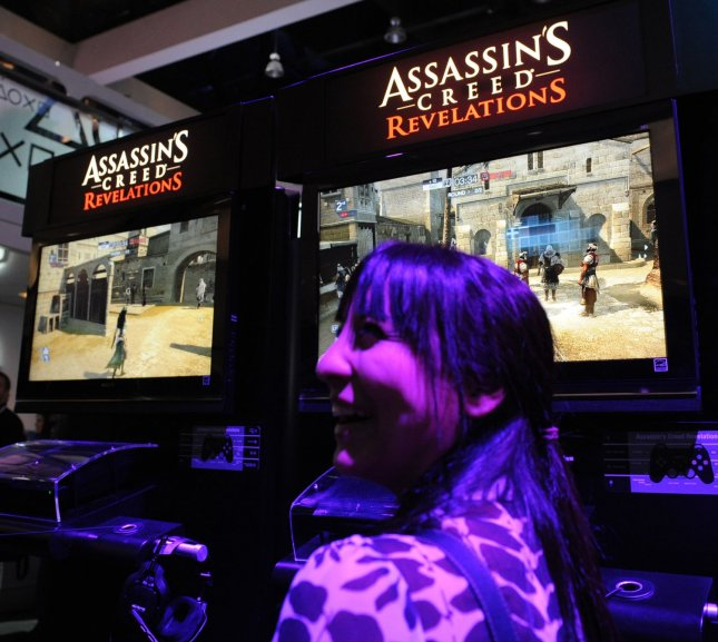 A gamer plays a video game at the E3 Electronic Entertainment Expo in Los Angeles on June 7, 2011. More than 45,000 people are expected to attend the annual three-day E3 Electronic Entertainment Expo to see the latest games and announcements from the gaming industry. UPI/Jim Ruymen